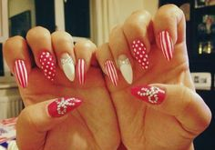 hot pink pointy nails, with gems and bows
