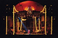 (Penton Media Inc., David Bowie's Glass Spider): General lighting illuminates the musicians, while a blue spotlight points out Bowie.  The key feature though is the illuminated shell of the spider above the stage.  I love how the designers made the entire spider out of light.  The eyes glow blue, the legs are tubes of light, and the shell is illuminated from the inside.