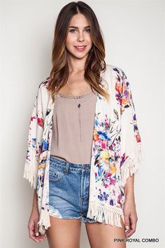 This lightweight kimono is perfect for all seasons! Great addition to any outfit.  Floral Kimono sweater with Frayed edged.
