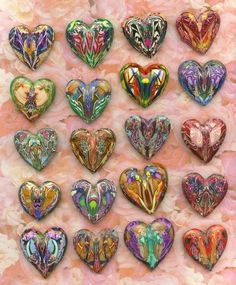 Great way to use up scrap bits of polymer clay left over from other projects ... combine them, roll into a tear-drop shape, carefully open the teardrop out to create a heart with mirror-image patterns on each side.  Tutorial by Elissa Powell ( all steps are explained, and have accompanying photos to illustrate the process ).