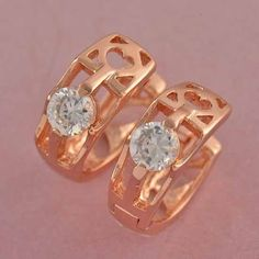 9K Rose gold-filled hoop cut out CZ earrings - 14mm x 5mm @ AUD$12.00 + postage or local pick up available.