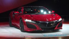 It's the car Acura fans have been waiting over two decades for, a new Acura NSX, and it's finally made its debut at the Detroit Auto Show today. Acura Supercar, New Acura Nsx, Detroit Auto Show, Dual Clutch Transmission, Olympus Digital Camera, New Engine, Electric Motor, Luxury Cars, Dream Cars