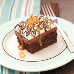 """Fudgy Chocolate Dessert Recipe -With a cake-like brownie bottom and layers of chocolate and hot fudge, this scrumptious treat is a chocolate lover's dream. """"It's my most requested recipe,"""" Bonnie Bowen confirms from Adrian, Michigan."""