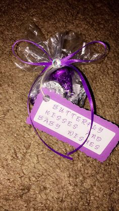 """Hershey """"butterfly"""" kisses. Baby shower party favor. Treat bag with kisses, cardstock tag with butterfly font, pretty purple ribbon tied into a bow with one rhinestone hot glued in the center to help the bow stay in place."""