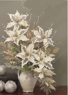 Lighted Silver Willow Branches in a Christmas poinsettia arrangement