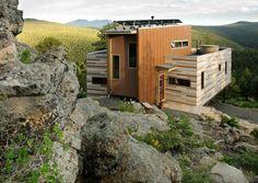 A solar-powered shipping container house in Colorado. #design #reuse