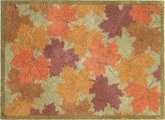 Maple Leaf Turtle Mat. The perfect doormat for autumn featuring orange and brown leaves. Available in large runner size as well as a door mat, this rug is created in partnership with the Royal Horticultural Society. From £49.95
