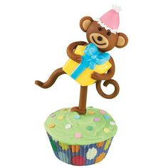 Help guests get their groove on with birthday cupcakes sporting dancing fondant monkeys.