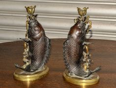 Pair of 19th Century Fish Candlesticks | From a unique collection of antique and modern decorative objects at http://www.1stdibs.com/furniture/more-furniture-collectibles/decorative-objects/