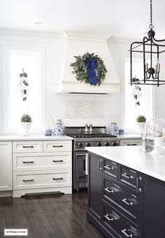 Loving the tall narrow windows in this kitchen, and limited upper cabinets!  Will go with gold for hardware and a different lantern and probably marble for the countertops.
