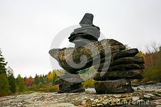 An Inukshuk on the Rocks in Whitney, Ontario