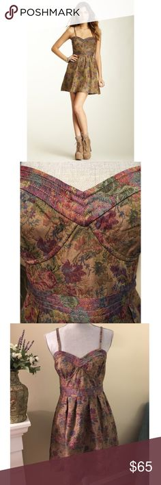 """Free People Floral Tapestry Sundress NWT $148 Empire waist, sweetheart neckline with built-in bustier, adjustable and removable spaghetti straps, elasticized back, hidden side zipper, fully lined, all over floral tapestry print. Fun, feminine, flirty. 💕😊 ***NOTE: This dress is a size 10, but not true to size. I normally wear a size 4 and it fits me perfectly. Measurements are: 30"""" waist, 34"""" bust, 27"""" length, not including straps. 100% polyester shell, machine wash cold, line dry, may also…"""