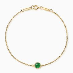 Tiffany's Elsa Peretti Cabochon bracelet in 18k gold with green jade // Gorgeous -- and Baylor green and gold! #SicEm
