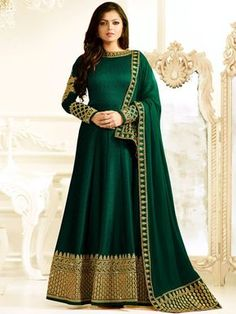 Shop Drashti Dhami bottle green color silk party wear anarkali kameez online at kollybollyethnics from India with free worldwide shipping.