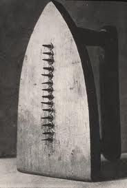 Man Ray. 'The Gift'  He took useful objects and turned them into impractical