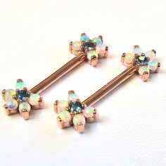 The loveliest of barbells with London blue topaz and opals in rose gold. For very serious girly girls. Jewelry by @bvla #goldforeverybody #ootd