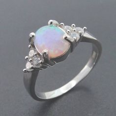 Check out this item in my Etsy shop https://www.etsy.com/ca/listing/513392811/opal-sterling-silver-ring