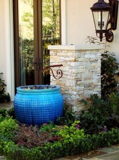 Great idea to put a screen topped with small stones to filter out the inevitable debris that will collect in a pot fountain.  The screen with the stones make it easy to clean.