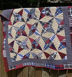 Western Kaleidoscope.  Wonderful memory quilt made with grandpa's western shirts.