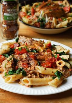 Chicken pasta with spinach and bacon in creamy tomato sauce