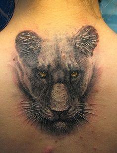 Amazing 3D Lioness Head Tattoo On Upper Back