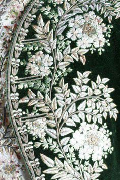 A gentleman's embroidered green velvet court coat and matching ivory satin waistcoat, French, circa 1790, heavily embellished with floss silk flowerheads and foliage;:  On the waistcoat the embroidery is slightly faded overall, the pale beige/pink leaf sprigs for example were originally rose pink.     from Kerry Taylor Auctions   You might like to read the condition report to give yourself an idea of perhaps why this only sold for £900 in 2004 bearing mind some of the numerous alterations…