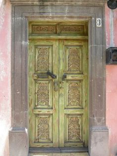 Huge ornate front doors in mexico.