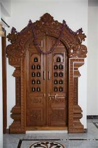 Heavy wooden carved temple doors, India