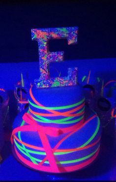 Neon ribbon wrapped fondant uv cake
