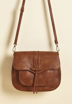 Give Them Something to Toggle 'Bout Bag in Brown. Theres a change in the soft roar of cafe chatter the moment you enter the coffee shop with this brown purse. #brown #modcloth