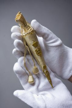Silk and gilt cone of rice confetti carried by one of Queen Ena's bridesmaids at her wedding to King Alfonso XIII of Spain in Madrid, 1906.
