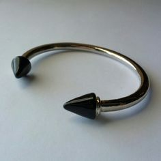 Edgy conical spike silver cuff bracelet Black enamel tips on a modern classic.  Nice weight, substantial feeling.  I'm not sure if I ever wore this...perhaps once.  Great condition! Jewelry Bracelets