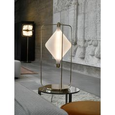 This table lamp features a large geometric lighting form based upon extensive study of the opportunities presented by creating light sculptures within mathematical grid systems. Home Ceiling, Handmade Lamps, Metal Chairs, Bedside Lamp, Mug Decorating, Lamp Design, Hand Blown Glass, Decoration, Floor Lamp