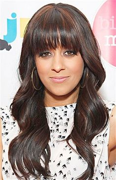 For anyone with bangs, Mowry's look is foolproof -- regardless of hair-length. Blow dry with a round brush, and wrap hair around a medium-size curling iron. Create bigger waves in a large section right where bangs end, keeping the top flat. Any higher and bangs won't fall right.