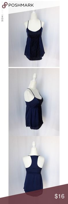 """{kirra} silky lace camisole A gorgeous navy silky csmisole with a black lace overlay over the chest. Features an elastic waist and flowy bottom for the perfect fit. Sexy yet girly.  Perfect paired with a blazer, slacks and high heels for a professional look at work, or pair with jeans and flats for a more casual yet chic look.  From Pac Sun. Brand is Kirra. Brand new with tags. Size XS. Length ~23.5"""" Polyester.  Mannequin measurements: 33"""" bust, 26"""" waist, 35"""" hips Kirra Tops Tank Tops"""