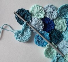 How to Crochet Sea Pennies   I want to do this with my pink and black yarn and make a massive throw!!