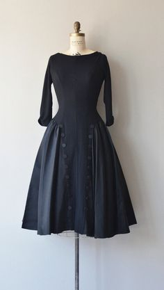 Vintage 1950s black formal dress with wool jersey bodice, scoop neckline, 3/4 sleeves, princess seams, tuxedo button detail, wool and taffeta skirt  I just adore this dress!
