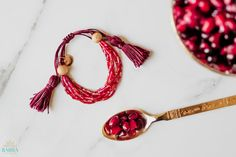 Inspired by the deep ruby red colour of the fruit, Pomegranate is a handmade multi-strand bracelet made with fine glass beads, 22k gold plated beads and an adjustable sliding knot.
