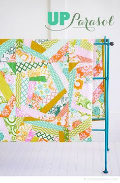 Would love to do this quilt in low-volume prints or lots of neutrals with some pops of color. Heather Bailey's design.
