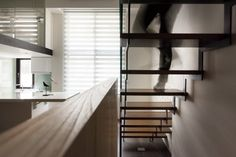 Light spills in from the tall windows and floods the room. The spaces between the steps are especially clever, as it allows for the light to continue its travels.