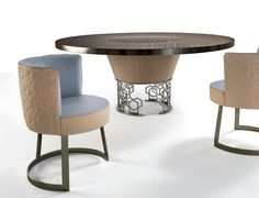 "Table with base formed from ground laser-cut metal with a curved ""Sequence"" decoration. Frame covered in sample leather. Structure finish: bright.."