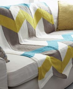 Free Knitting Pattern for Color Pop Chevron Afghan - This easy throw by Bernat features zigzag stripes formed by knitting long striped strips and seaming them together.