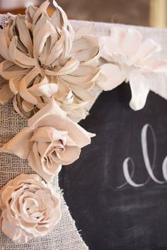 Plaster flowers on burlap framed chalkboard  The Wedding of Elaine and Denver Photo By C2 Photography