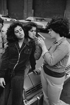 by Susan Meiselas  Pebbles, JoJo and Roe on Baxter Street. From the Prince Street Girls series, 1978.
