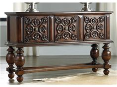 Shop for Hooker Furniture Melange Broderick Console, 638-85049, and other Living Room Tables at Whitley Furniture Galleries in Raleigh, North Carolina. Deeply and intricately carved drawer fronts, an exaggerated leg shape and a uniquely designed stretcher punctuate the Broderick Console.