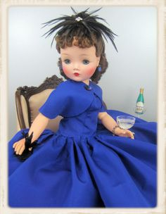 A favorite for glamour and style! 1957 brunette Cissy #2140 stylish in a gorgeous electric sapphire blue taffeta dress with a short cape-style bolero.  Owned by Karen/Doll Avenue.