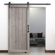 One Panel Barn Door in Rustic Knotty Alder Winter White Finish. Philmont Hardware and Corona Handle set featured on door.