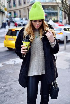 Beige Knit Sweater, Dark Jeans, Coat, Neon Beanie, Long Strap Purse, Pink Lips.