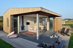 Weekend house http://freshome.com/2014/11/30/small-and-charming-weekend-house-with-an-optimum-level-of-openness/