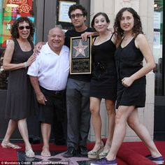 Daddy cool: Danny with wife Rhea Perlman, son Jacob, and daughters Lucy and Grace in 2011...